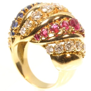 Impressive Fifties Cocktail ring with three diamond rows alternating with rubies